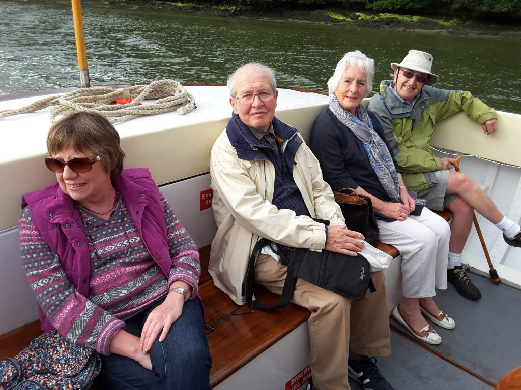 Friends enjoying a calm journey on the River Fal.