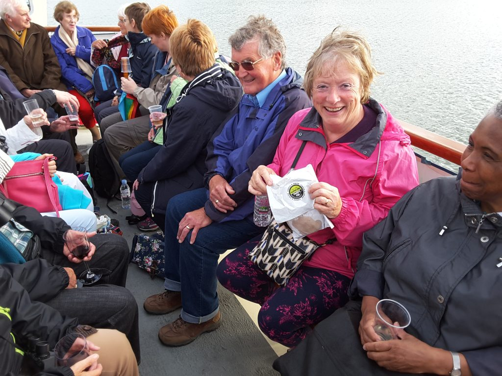 Friends enjoying catching up on the River Fal.